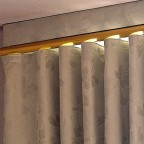 This pelmet fixed to a ceiling, is an original design made possible by the Uni-Q track profile. It is cut out to go around the cornice and uses U-pleat décor rod fixed to the base of the pelmet. The curtain runs on the rod.