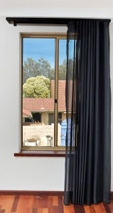 As shown, one-way tracks allow a single-sided window to open without blowing drapes about.